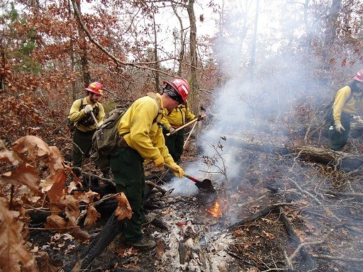 Firefighters patrol the fire line in Mark Twain National Forest. - COURTESY USDA.GOV
