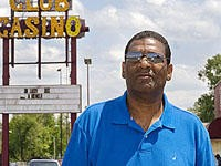 Club Casino owner Cedric Taylor stands in front of his nightclub on State Street in East St. Louis - JENNIFER SILVERBERG