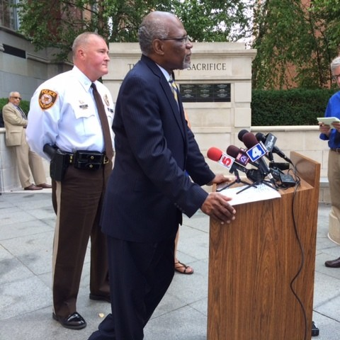 """County Executive Charlie Dooley, with police chief Jon Belmar behind him, tells media he is disappointed in the lootings Sunday night in Ferguson. """"I understand the community's frustration and desire for information."""" - LINDSAY TOLER"""