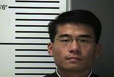 Father Joseph Jiang's mugshot.