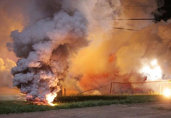 Tear gas fired in Ferguson. - DANNY WICENTOWSKI