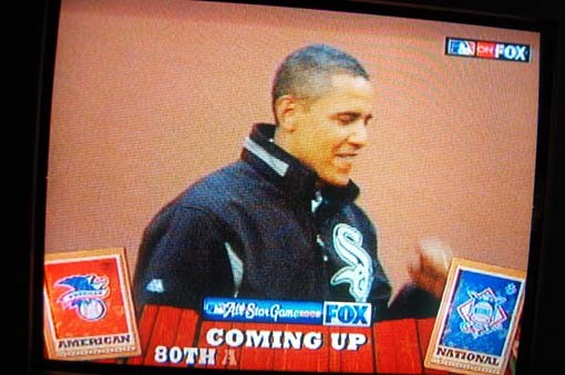 A replay of Obama's first pitch wraps it up. And we're onto the game!