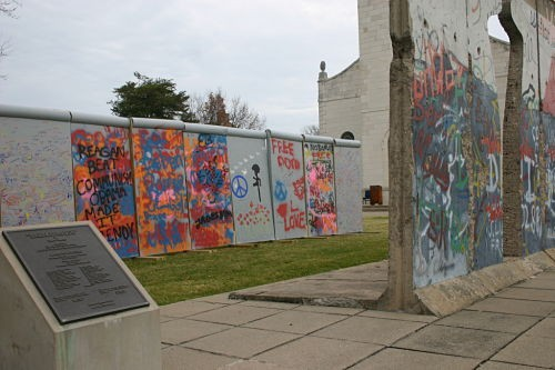 The two Berlin Walls, side by side. In the background, the Church of St. Mary the Virgin, designed by Christopher Wren in the 17th century and transported stone by stone from London to Missouri. - ROB CROUSE