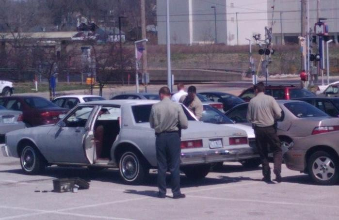 St. Louis County police investigate a primer gray Chevrolet Impala involved in shooting. - AMIR KURTOVIC