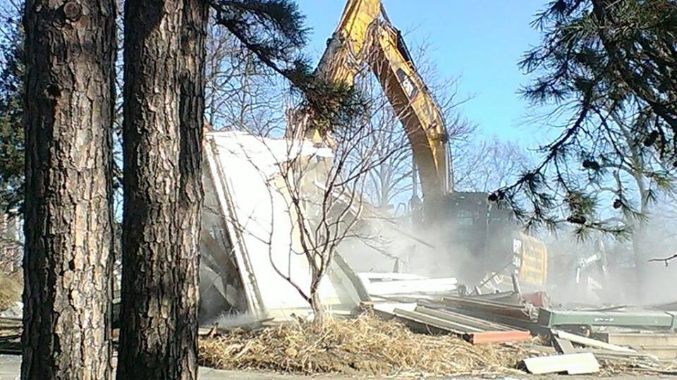 A bulldozer demolishes the Book House's old home in Rock Hill. - PHOTOS COURTESY OF MICHELLE BARRON