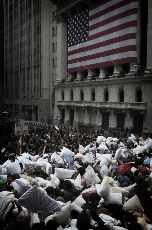 With a heavy police presence, dozens of photographers, and gawking pedestrians, World Pillow Fight Day 2009 found its voice outside the New York Stock exchange, where 45 minutes was enough time for hundreds to converge, battle, and leave a flurry of white feathers in their wake. - PHOTO: PAUL CRISPIN QUITORIANO/VILLAGE VOICE