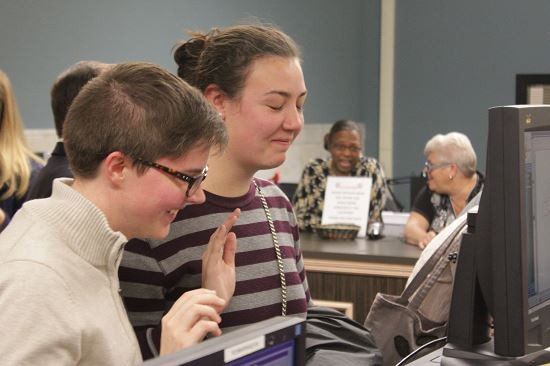 Sadie Pierce (on left) and Lilly Leyh took their oaths Wednesday afternoon, becoming the first same sex couple to marry after a judge struck down Missouri's ban on gay marriage. - ALL PHOTOS BY DANNY WICENTOWSKI