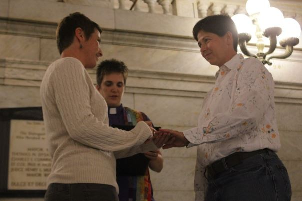 After making it legal, Crystal Peairs (left) and April Breeden made their marriage official by having a ceremony in the City Hall rotunda.