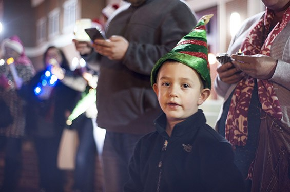 Liam Maupin helps spread the Christmas cheer in front of the Ferguson Fire Station on South Florissant Road. - ALL PHOTOS BY KELLY GLUECK