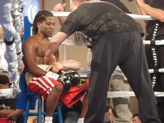 Dannie Williams, here listening to instructions from his trainer Jack Loew during his August fight against Antonio Cervantes, is hoping for a shot against Hank Lundy. - ALBERT SAMAHA