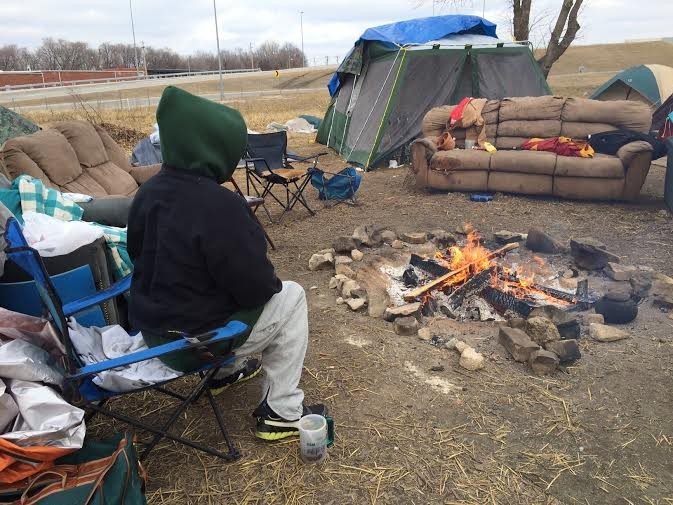 Keeping warm by the fire in St. Louis' homeless camp near the Stan Musial Veterans Memorial Bridge. - PHOTOS BY LINDSAY TOLER