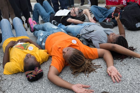 Some protesters lay down in the middle of the road near the I-70 off ramp. They were arrested. - BRYAN SUTTER