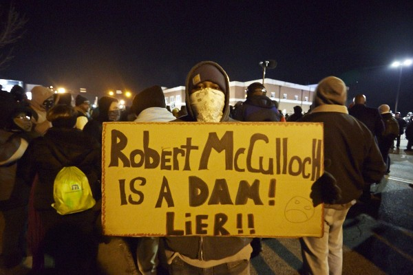 Protesters are directing their (somewhat misspelled) anger at St. Louis County Prosecutor Bob McCulloch -- but could they remove him from office? (See more protest photos here). - THEO WELLING