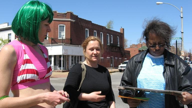 Lyndsey Scott (left) and Rita Ford (far right) discuss the plaza proposal - PHOTO BY NICHOLAS PHILLIPS