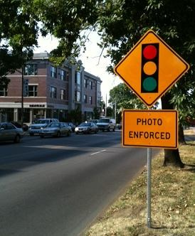 A sign alerts drivers of new cameras at Skinker and Forest Park Parkway.