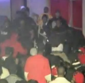 Dozens of people skirmish around 4:30 a.m. Saturday at Blackmon's. - YOUTUBE