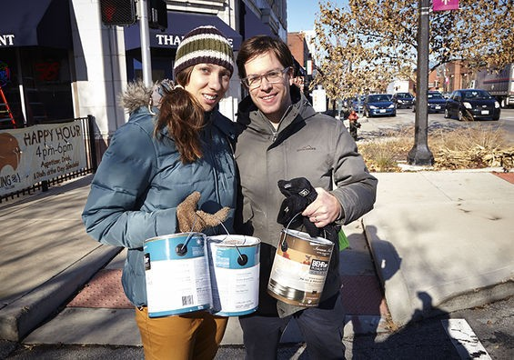 Volunteers transform South Grand's broken windows into painted murals. - STEVE TRUESDELL