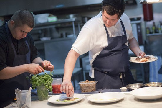 Owner and chef Mike Randolph plating a dish at MEDIAnoche - CRYSTAL ROLFE
