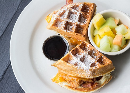 """Chicken 'n' Waffle Sandwich"": fried chicken topped with cheddar and bacon in a buttermilk waffle."