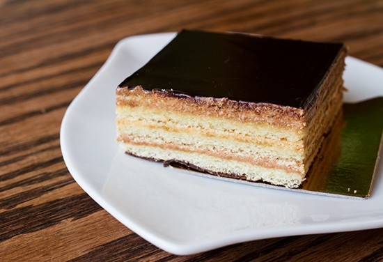 An Opera torte made up of almond cake, buttercream and coffee.