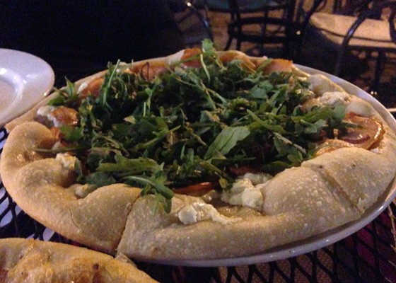 Smoked salmon pizza with capers, red onion, goat cheese and fresh arugula.   Nancy Stiles