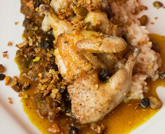 """Juniper's """"Country Captain"""": curry-glazed quail, Carolina-gold rice, currant stew and pistachio granola. 