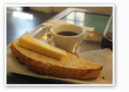 Toasted French peasant bread with Havarti cheese and Cesmach coffee at Blueprint Coffee.   Nancy Stiles