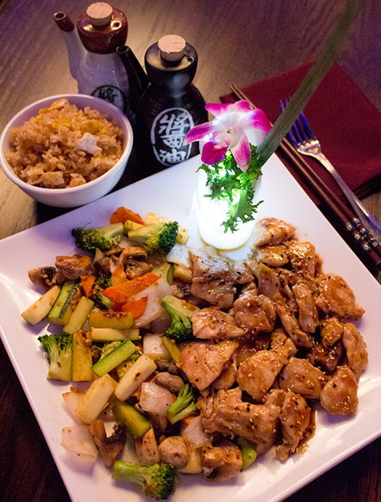 The hibachi chicken dinner ($14.95) served with a choice of side. - MABEL SUEN