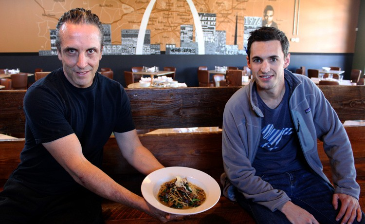 Chef de cuisine Marc Foley and operator partner Ryan French present Gut Check with a plate of funghi pasta atop the restaurant's oversized bench. - MABEL SUEN