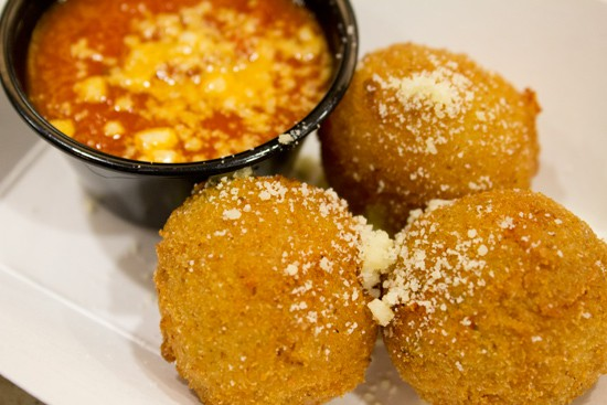 """Original"" cini filled with sausage, peas, parmigiano and pecorino cheese. - MABEL SUEN"