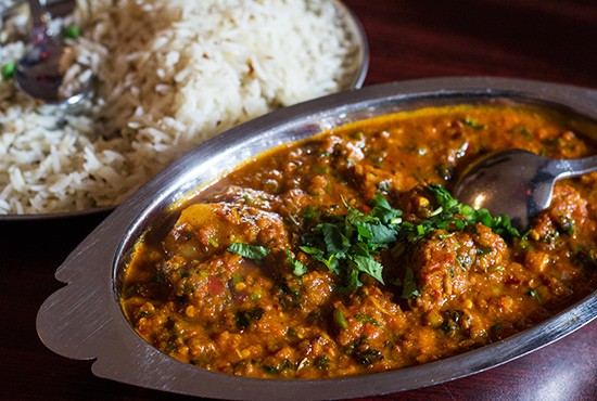 Lamb vindaloo cooked in hot spicy sauce and potatoes with basmati rice. - PHOTOS BY MABEL SUEN