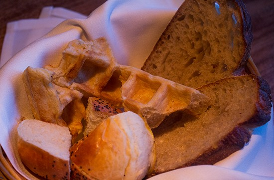 Each meal begins with an assortment of bread and waffles. | Mabel Suen