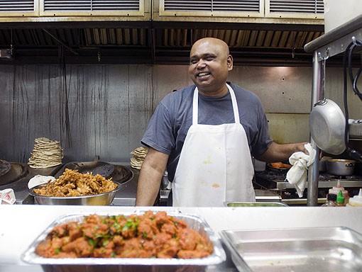 Head Chef Nagabhushanam looking less serious and enjoying his work at Mayuri in Creve Coeur. See photo slideshow from Mayuri. - PHOTO: JENNIFER SILVERBERG