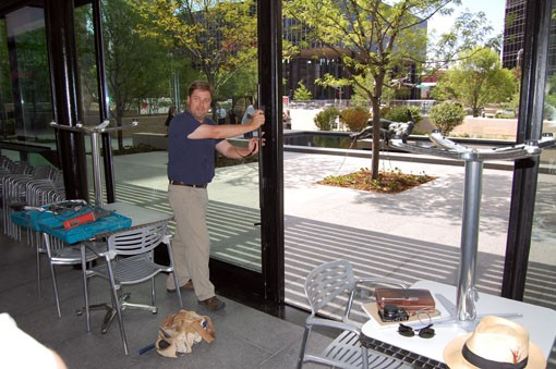 James Fiala, owner of Terrace View Cafe, gives the sliding door at the restaurant a test-opening. - PHOTO: NICK LUCCHESI