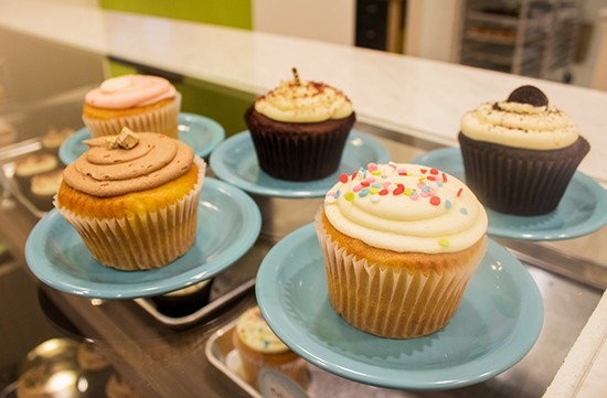 An assortment of the Cup's cupcakes: (clockwise from top left): raspberry beret, red velvet, tuxedo, confetti and gold rush. - PHOTOS BY MABEL SUEN