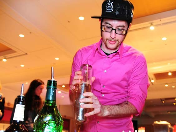 "Ryan ""Burns"" of the Bleeding Deacon Public House prepares the Uptown cocktail. - PHOTO: EGAN O'KEEFE"