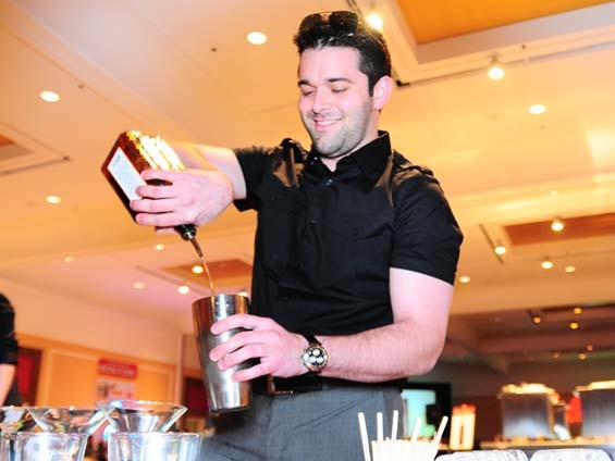 "Ryan Sloss of Quintessential smiles over his ""Stoli-infused Q-Cosmo."" - PHOTO: EGAN O'KEEFE"