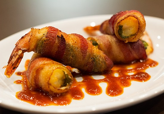 """Shrimp & Jalapeno Firecrackers"" ($10) stuffed with herbed goat cheese and wrapped with rubbed bacon."