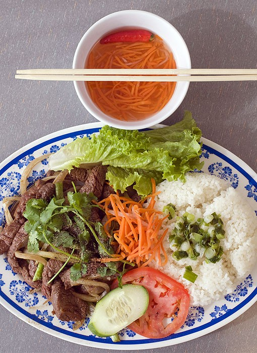 The Cóm Bo Luc Lac is broken rice with sliced beef and vegetables. See more photos from the kitchen of Phuc Loi in this slideshow. - PHOTO: JENNIFER SILVERBERG