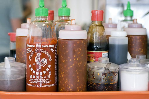 Toppings, sauces and spices available to diners at Phuc Loi. See more photos from the kitchen of Phuc Loi in this slideshow. - PHOTO: JENNIFER SILVERBERG