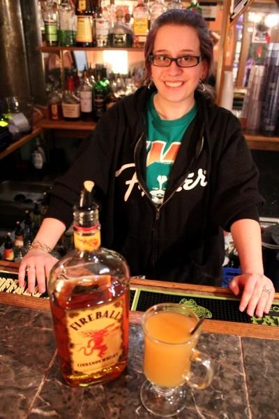 Bartender/server Stephanie Dinges with a hot spiked cider. - MABEL SUEN