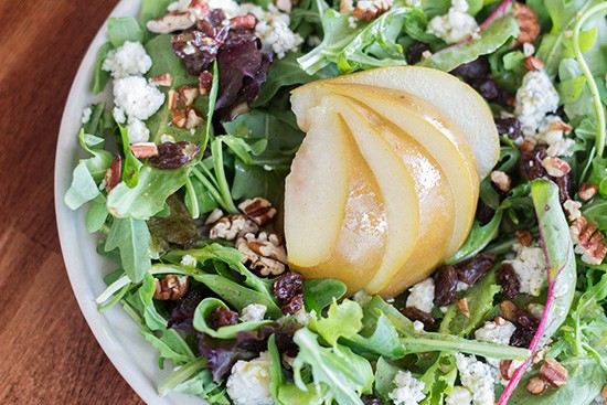 Pear salad with arugula, blue cheese, toasted pecans and honey-oregano vinaigrette.