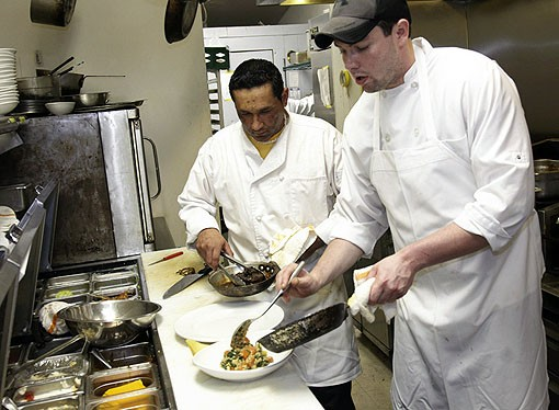 Mike and Julio plating the Beef Burgundy. See more photos from Molly's in our slideshow. - PHOTO: STEVE TRUESDELL