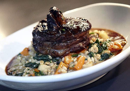 Molly's Beef Burgundy over barley risotto and roasted root veggie. See more photos from Molly's in our slideshow. - PHOTO: STEVE TRUESDELL
