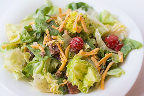 """Smokehouse"" salad with butter lettuce, corn salsa, pancetta, smoked cheddar, pear tomatoes, bacon and barbecue ranch dressing."