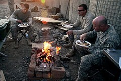 A Thanksgiving dinner with U.S. troops in Afghanistan. - WIKIMEDIA COMMONS