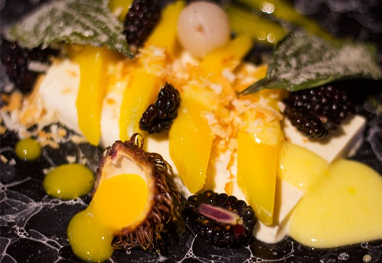 Coconut semifreddo with compressed mango, candied shiso, yuzu curd, mango puree, toasted coconut and blackberries.