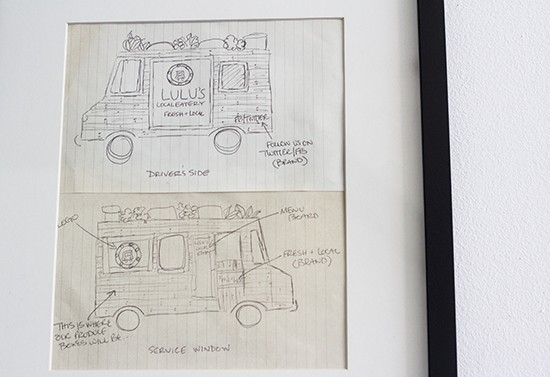 A sketch of Lulu's food truck hanging in the dining room.