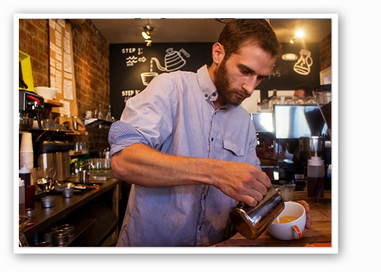 Carefully pouring a latte. | Mabel Suen