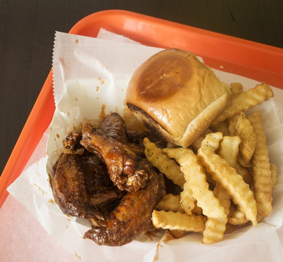 """Sweetnspicy"" chicken wings with fries and a roll. 